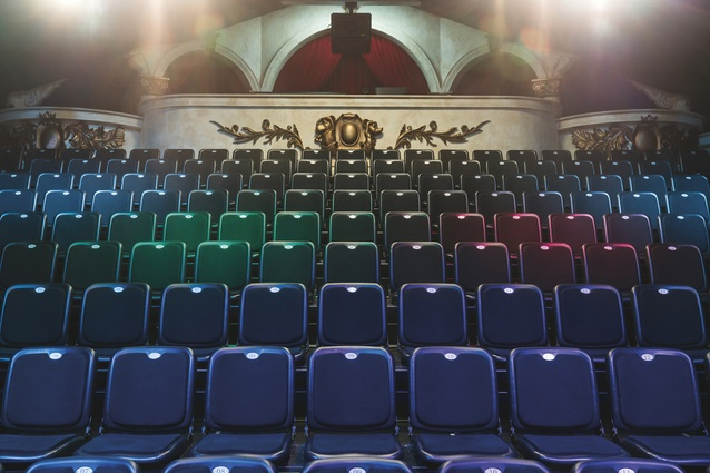 The theatre seats 115 people and has traditional theatre elements such as the curved control booth with its ornate embellishments.