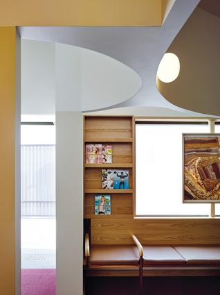 The soft curves of the bespoke ceiling can be most appreciated in the waiting room.