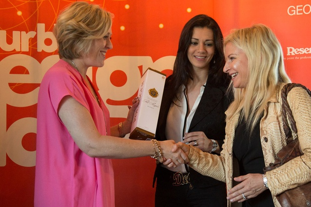 Kirsten Matthew presents a gift of Pol Roger champagne to Heba Hilali of spazioCasa and fashion designer Yvonne Bennetti.