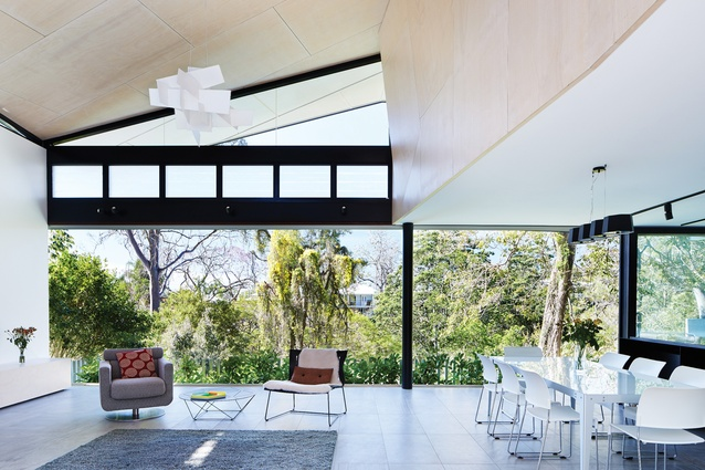 The living room is transformed into an indoor verandah that provides an engaging connection to the treetops.