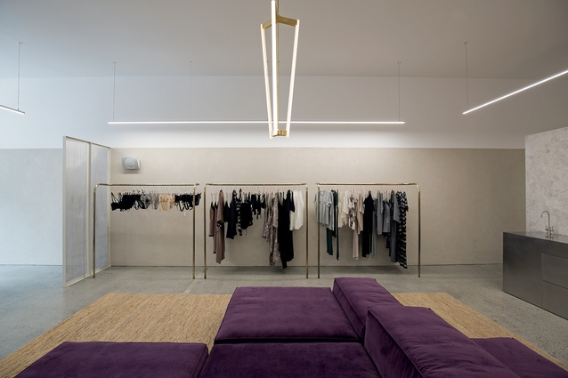 Minimalist lighting by Michael Anastassiades and bespoke brass display units are in keeping with the gallery-like interior.