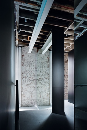 Mirrors reflect the textures and structure of the original walls and ceiling and bring awareness to the physical space.