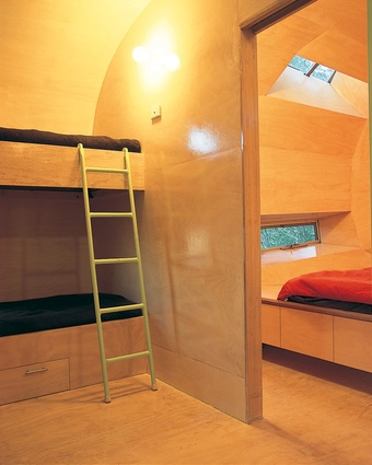 A bunkroom sits adjacent to the main bedroom.
