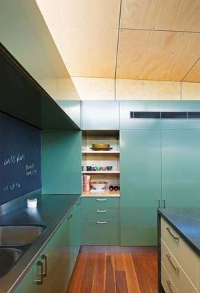 The kitchen features a cafe-style blackboard splashback, perfect for recipes and games.