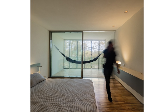 Each bedroom has a small covered deck with Paola Lenti hammocks.