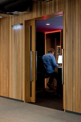 The retro-look timber panelling brings an element of warmth and texture to the fast-paced, hi-tech environment.