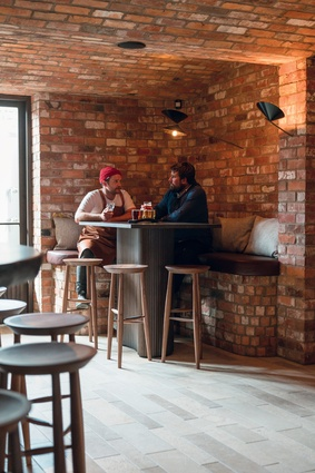 Recycled bricks create a sultry, masculine space in the Alibi bar.