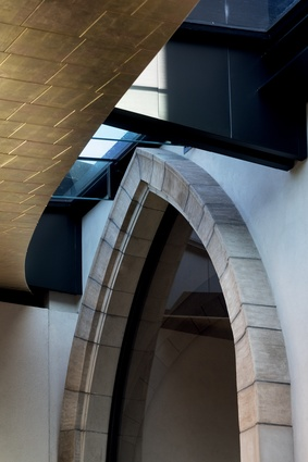 Overhead, an elliptical wedge of glazing draws in light to the back of the chapel.
