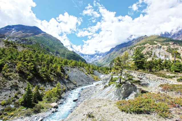 The Marsyangdi River between the village of Pisang and the town Manang, with the mountain peak Annapurna III in the background.