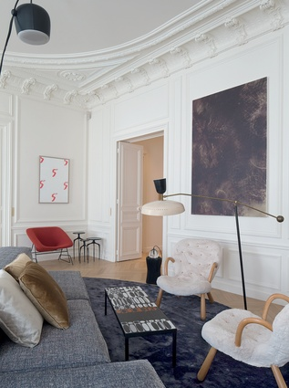 Classic elements and colours are mixed with a range of eclectic furnishings and colours in this  Parisian apartment.