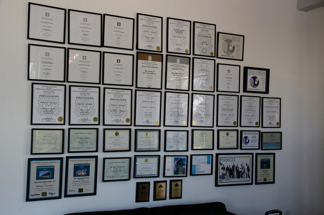 An accolade of design awards displayed in the foyer.