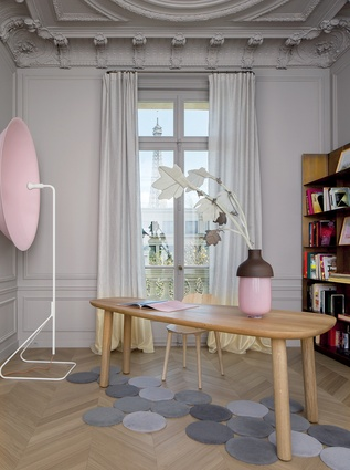 "Furniture includes the Philip Arctander's 'Clam"" chair (circa 1944), desk by Jasper Morrison, vase from Hella Jongerius and Parabola wall lighting designed by Pierre Charpin."