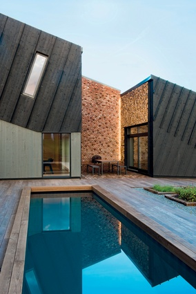 Snøhetta's ZEB Pilot House is an 'out-of-the-ordinary' zero-emission family house. Solar panels together with geothermal, provide energy for the house and an electric car.