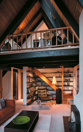A mezzanine above the reading nook houses a drum kit owned by of the boys.