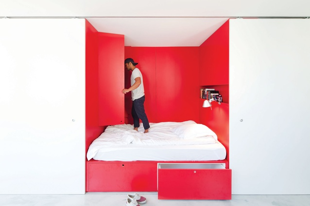 A queen-sized bed tucked into the 1.2-metre-deep joinery wall can be hidden or exposed as desired.