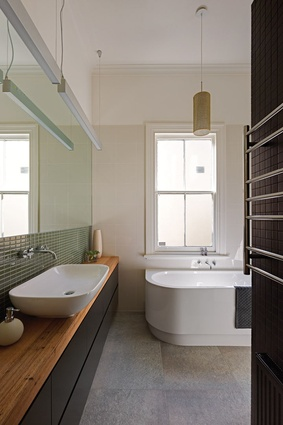 The bathroom merges elements of the old and new.