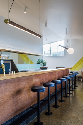 The hotel retains its mid-century timber bar and is surrounded by a colour palette inspired by the beach.