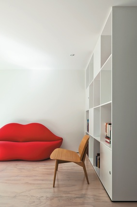 Bold furniture like the Lip Sofa from Design 55 jazzes up the simple economical interiors.