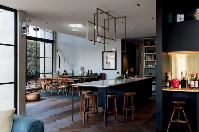 Twice-smoked oak parquet floors in the open-plan kitchen, dining and living spaces add warmth and visual interest to the interior.