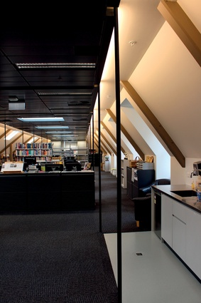 The refurbished interior is now an open-plan office space.