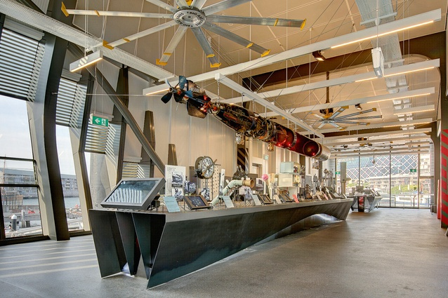 The exhibition in the multi-use space designed by studioplusthree commemorates 100 years of the Royal Australian Navy, with physical and digital pieces clustered around bespoke steel tables.