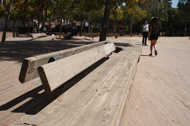Benches formed from salvaged railway sleepers, the back rests located on both sides, providing more flexible seating at Flores & Prats' Fabra and Coats Gardens