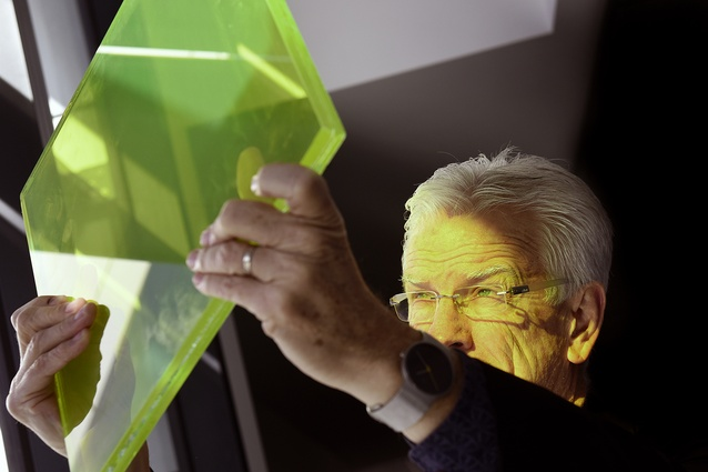 Principal of Hassell, Ross de la Motte, looks at one of the coloured light pieces.