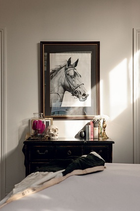 A vintage drawing takes pride of place in the master bedroom.