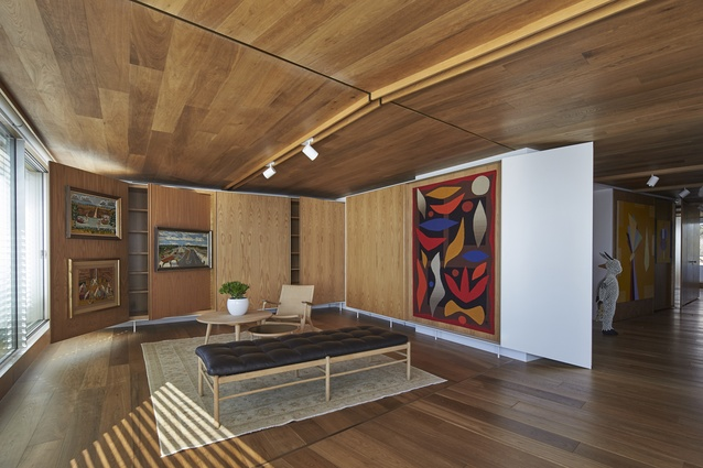 American Oak joinery pieces and panels with sliding or hinged doors were designed specifically to house and display the owner's sizeable art collection.