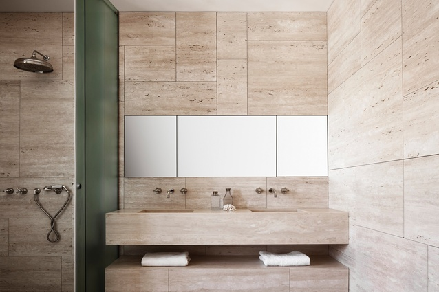 Bathrooms use a light travertine where the pores were left open to give life to the material.