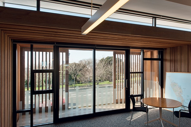 Louvred cedar shading on the balcony matches the unevenly expressed panelling seen throughout the interior.