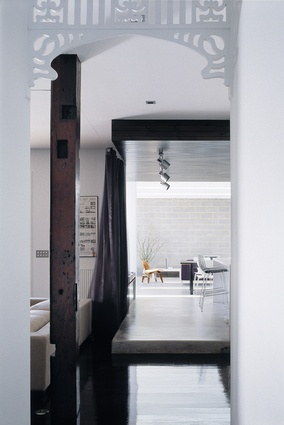 The dilapidated house was transformed into a beautiful, minimalist home that celebrates the original detailing.