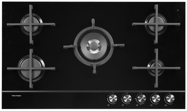 Gas cooktop on glass with iron trivets.