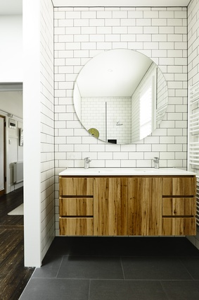 White tile lends a sense of light-filled spaciousness to the bathroom.