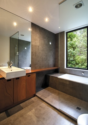 The bathroom cabinetry was designed by BOX Living.