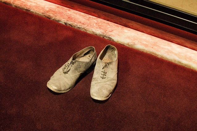 A mysterious pair of shoes was found in a wall cavity.