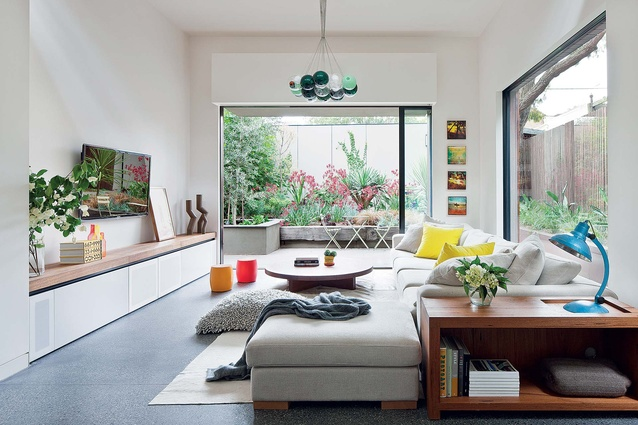 The bright and modern living room is part of the new extension to the house.