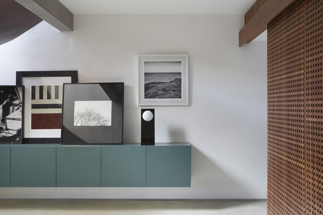 A palette of teal, warm woods, concrete and white offers a refreshing visual canvas for the sporadic blast of colours, artwork and tropical climate.