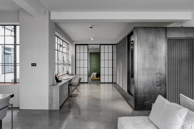 Located within a 1930s shoe factory, the apartment has a rich industrial past that has shaped the architect's approach.