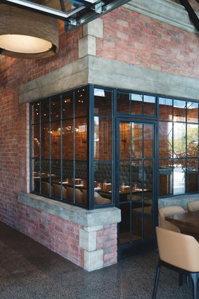 The Grounds restaurant features comfortable furniture in neutral tones.
