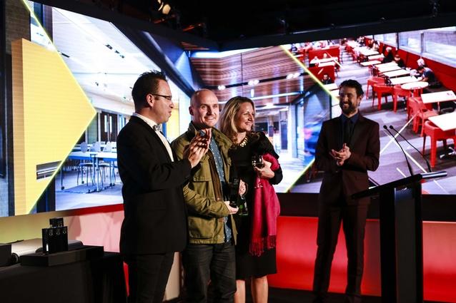 Scott Compton and Thalea Carruthers of WAM receiving trophy from Federico Monsalve, editor <em>Interior</em>.
