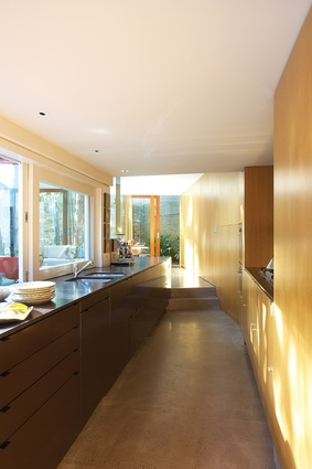 Circulation is via a new cranked, linear kitchen joined to the original house.