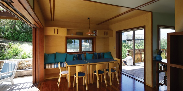 The dining area sits between two decks, one of which serves as the front door.