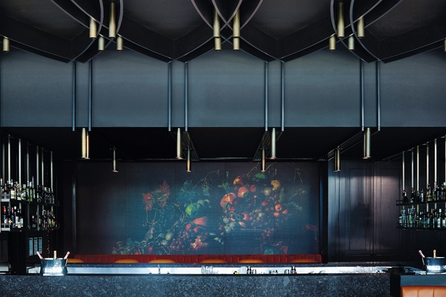 Behind the bar, a gossamer-thin copper mesh subtly obscures a tableau of fruit and foliage photographed by Romas Foord.