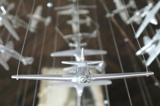 Close up of one of the 100 solid cast aluminium planes that make up the chandelier.
