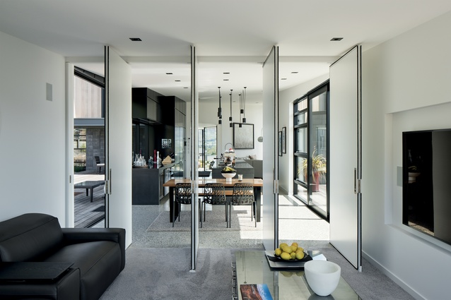 Fold-out doors connect spaces, creating open sight lines between indoors and out.