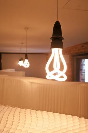 Energy efficient Plumen bulbs hang above Molo Softwalls.