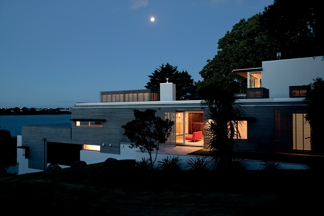 North Shore House, Auckland. This Architectus house steps down a steep hillside next to a reserve.