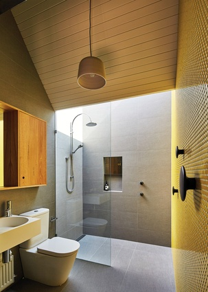 The main ensuite features a pop-up skylight over the shower for access to natural light in a private space.