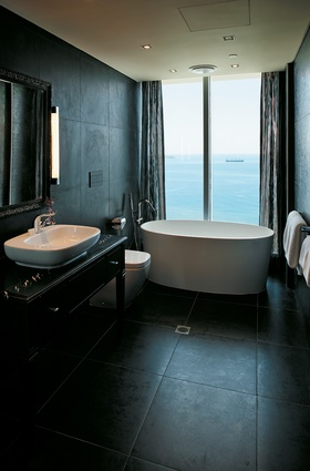 A typical suite with views out to sea from both bedroom and bathroom.